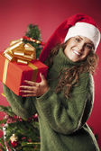 Happy girl and her gift — Stockfoto