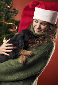 Beautiful girl holding a puppy — Stock Photo