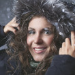 Young woman in a snowy hood — Stock Photo