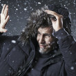 Man goes through a snow storm — Foto Stock