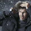 Handsome man wearing jacket with fur hood — Foto Stock
