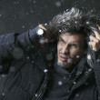 Handsome man wearing jacket with fur hood — Стоковая фотография