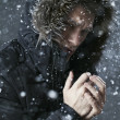 Guy in the winter snow at night — Stok fotoğraf