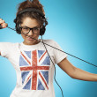 图库照片: Young womwith headphones listening music .Music teenager girl