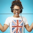 Young woman with headphones listening music .Music teenager posi — Stock Photo #35710417
