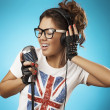Stock Photo: Singing Woman with Retro Microphone.