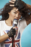 Singing Woman with Retro Microphone. — Stockfoto