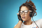 Young woman with headphones listening music .Music teenager girl — Stok fotoğraf