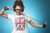 Young woman with headphones listening music .Music teenager girl — Foto de Stock