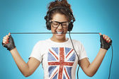 Young woman with headphones listening music .Music teenager posi — ストック写真