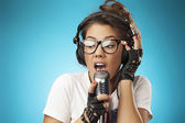 Singing Hipster with Retro Microphone. — Stock Photo