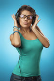 Woman with headphones listening music .Music teenager girl danci — Stock Photo