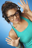 Young woman with headphones listening music . Dance — Stock Photo