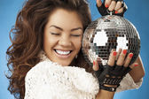 Girl & disco ball — Stock Photo