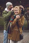 Lovers walk. The guy hugs a girl — Stock Photo