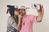 Couple in love taking a picture of themselves — Stockfoto