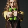 Young woman in sportswear with dumbbells — Stock Photo