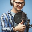 Close-up of mrecording vocals. Thumb up — Stock Photo #39028061