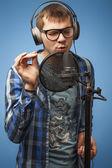 Singer in the recording studio — Stok fotoğraf