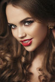 Portrait of beautiful girl with red lips, red manicure. Close up — Stock Photo