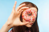 Girl looking through a donut — Stock Photo