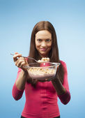 Girl with milk and breakfast cereals. portrait in the studio. bl — Stockfoto
