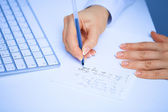 Hands writes a pen in a paper. Macro — Stock Photo