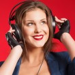 Stock Photo: Beautiful girl. Music. Portrait in studio.