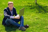 Business man on the grass. fashion style. talking skype. outdoor — Stock Photo
