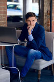 Young business man in the coffe house. fashion style. thinking — Stock Photo