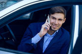 Young business man on the car. fashion style. talking skype. out — Foto de Stock