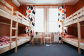 Hostel room with city view. Color room. Bright interior — Foto de Stock