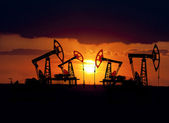Collage. Oil field at sunset. — Stock Photo