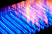 The fire burns from a gas burner inside the boiler. — Stock Photo