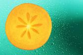 Slice of persimmon — Stock Photo