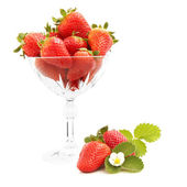 Strawberries in crystal vase — Stock Photo