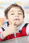 Child without a tooth — Stockfoto