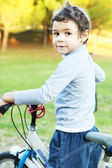 Child with bicycle — Stock Photo
