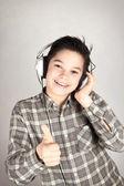 Happy teenager with headphones — Stock Photo