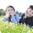 Brothers having fun in the park - Stock Photo