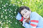 Boy lying on green grass — Stock Photo