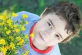 Boy with bouquet of wildflowers — Stock Photo