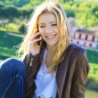 Young girl speaks by phone — 图库照片