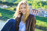 Young girl speaks by phone — Stock Photo