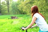 Girl on bike in nature — Stock Photo