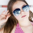 Beautiful little girl with sunglasses — Stock Photo