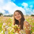 Happy little girl in the field — Stock Photo