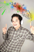 Happy teenage girl listening to music — Stock Photo