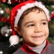 Happy child with hat of Santa Claus — Stock Photo