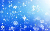 Winter blue background with snowflakes — Stock Photo